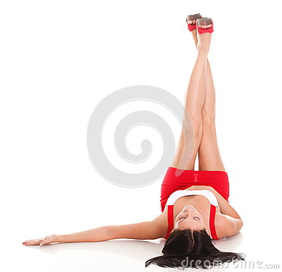 Woman lying with her legs raised straight up