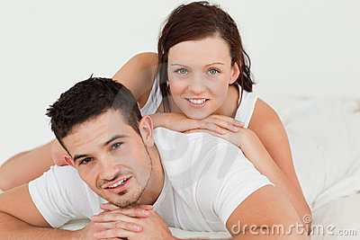 Woman lying on her man