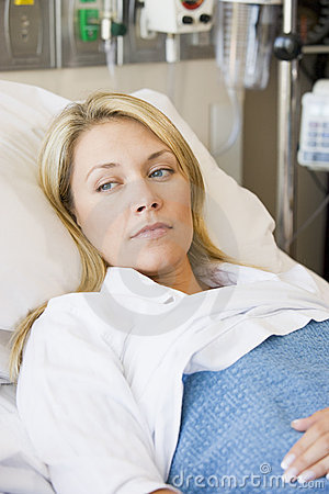Woman Lying In Hospital Bed