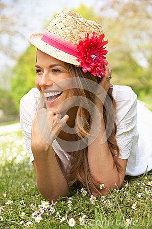 Free Woman Lying In Field Of Summer Flowers Royalty Free Stock Photo - 26104115