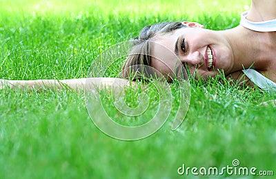 Woman lying on a lawn