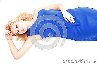 Woman lying lovely girl in blue dress over white