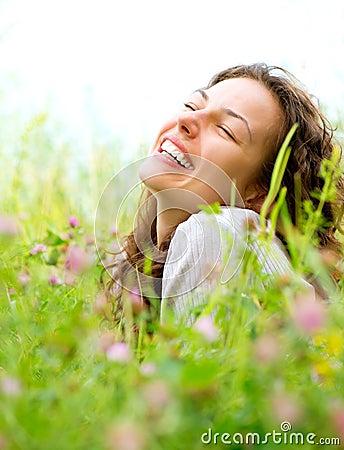 Woman lying in Meadow of Flowers