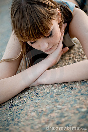 Free Woman Lying On Asphalt Royalty Free Stock Photography - 5130047
