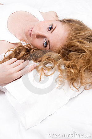 Woman lying on pillow