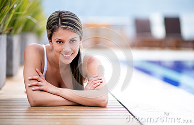 Woman lying by the pool