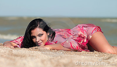 Woman lying on the sand