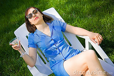 Woman lying on the sun lounger