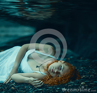 Free Woman Lying Underwater. Royalty Free Stock Photo - 56941955