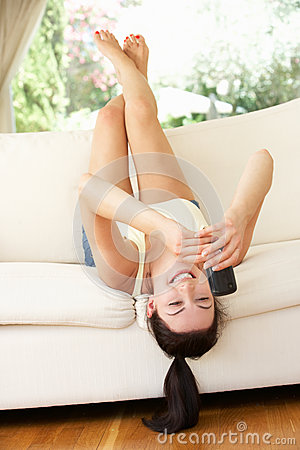 Woman Lying Upside Down On Sofa