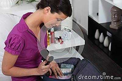 Woman with make-up bag
