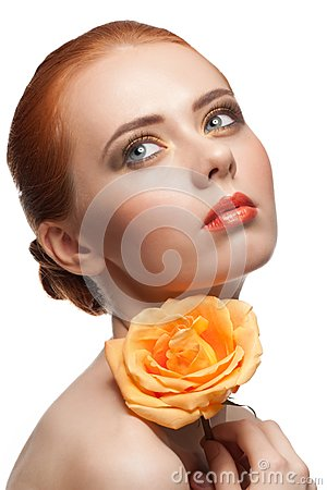 Woman with make-up and rose