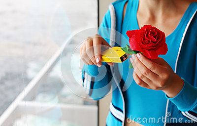Woman makes artificial red rose