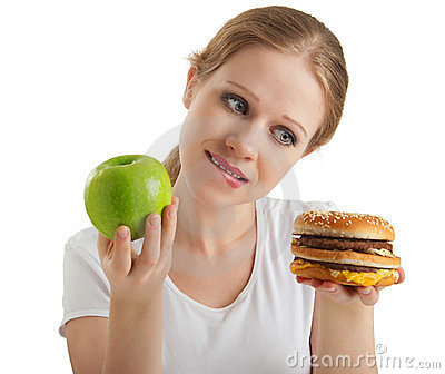 Woman makes choice, healthy and unhealthy foods