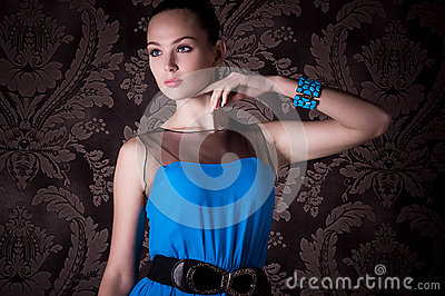 Woman with makeup in blue dress