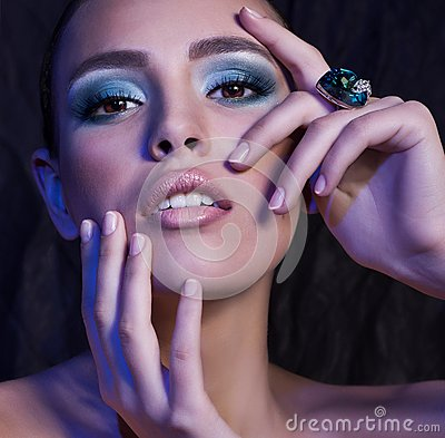 Woman with makeup in luxury jewelry