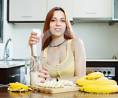 Woman making beverages  from bananas and milk