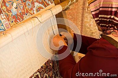 Woman Making Carpet Editorial Photo