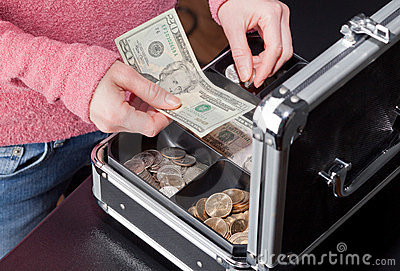 Woman making change from a cashbox