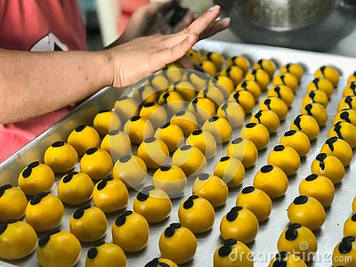 The woman is making cookies stuffed with pineapple. Stock Photo