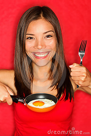 Woman making eggs for breakfast