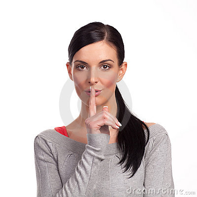 Woman making a keep it quiet - isolated