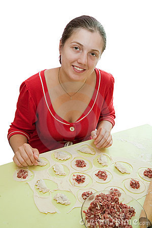 Woman making meat dumplings