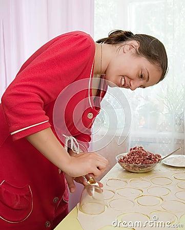 Woman making meat dumplings