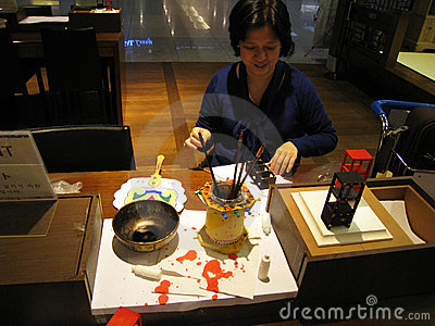 Woman making miniatures at Incheon Airport Editorial Image