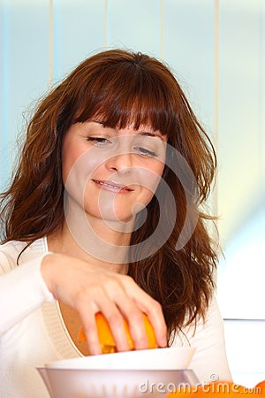 Woman making orange juice