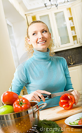 Woman making salad at kitchen