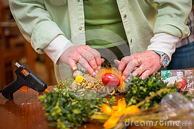 Woman making some easter decorations Stock Photo