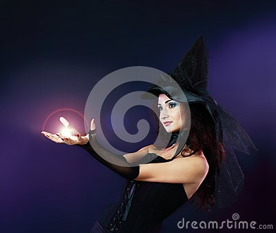 Woman making spell with magic fireball