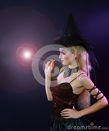 Woman making spell with magic wand