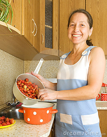 Woman making strawberry jam