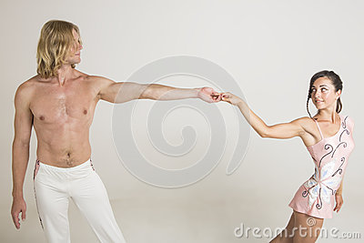 Woman and man acrobats hold hands