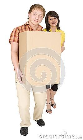 Woman and man bear the big cardboard box