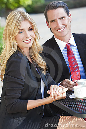 Woman & Man Couple Drinking Coffee At City Cafe