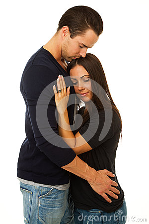 Woman and man embrace