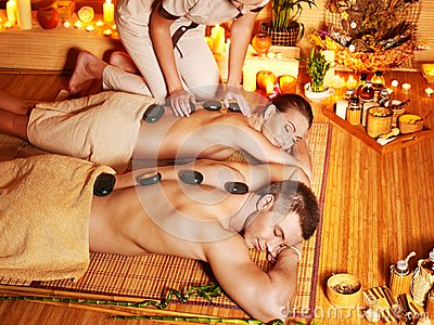 Woman and man getting  massage in spa.