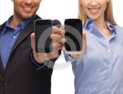 Woman and man hands with smartphones