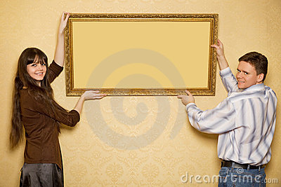 Woman and man hang up on wall picture