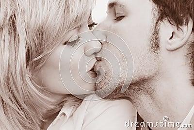 Woman and man kiss close-up