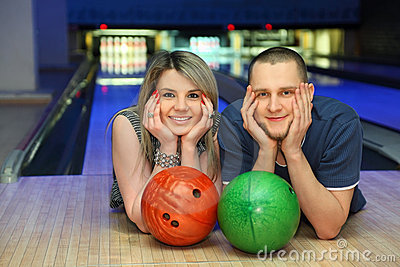 Woman and man lie alongside in bowling club
