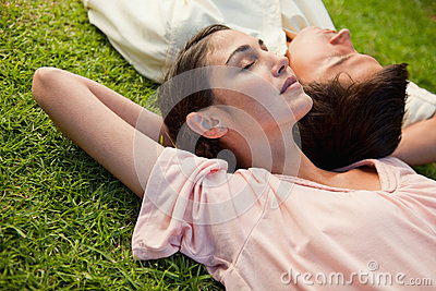 Woman and a man lying head to shoulder
