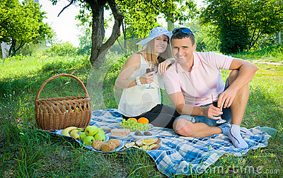 The woman and the man on picnic in park.