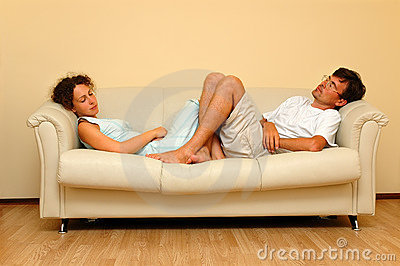 Woman and man repose on the white sofa