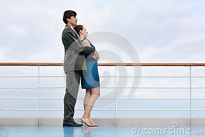 Woman and man stand on board of ship