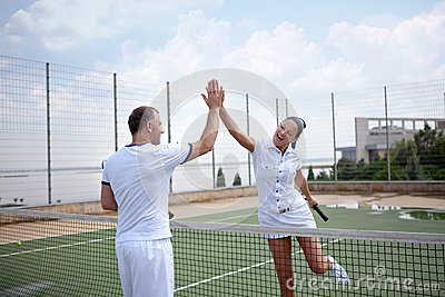 A woman and a man on the  tennis courts