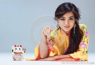 Woman with maneki neko cat